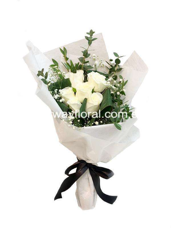 This bloom consists of white roses, white baby's breaths, cordyline, and eucalyptus wrapped in white wrapping.