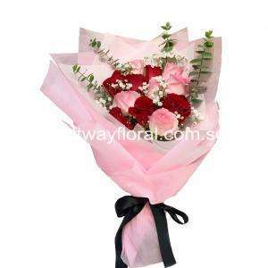 This blooms contain red roses, pink roses, white baby's breaths and foliage.