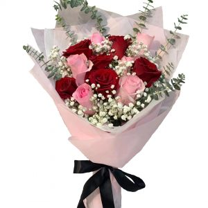 Red roses, pink roses, white baby's breaths and eucalyptus wrapped in light pink wrapping with black ribbon.