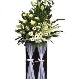 White Easter Lillies, Green Kales, White Gerberas, White Pom Poms, White Orchids (M-Size), Green Anthuriums, Golden Phoenix Sprays, Johor Ferns and Other Lush Foilages.