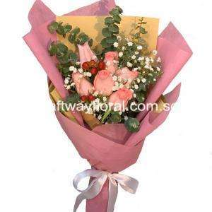This bloom consists of pink roses, red hypericums, white baby's breaths, and eucalyptuses.