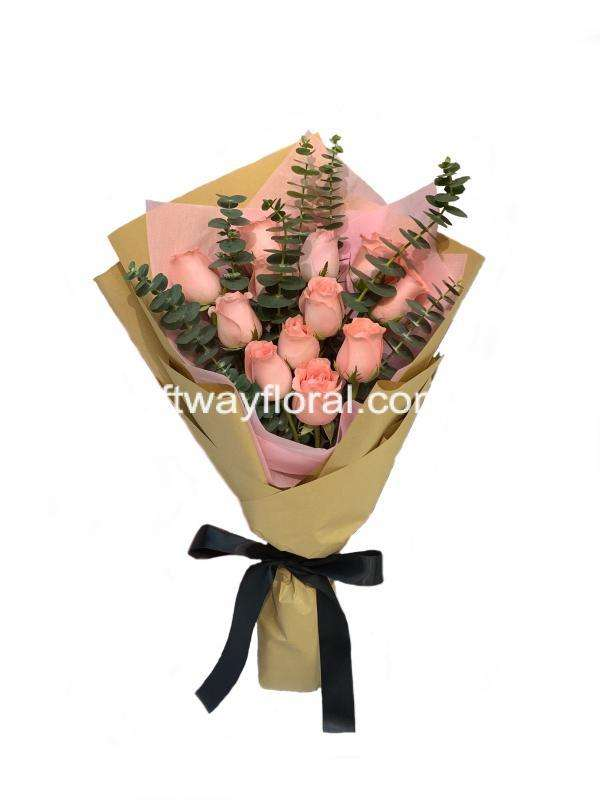 This bloom contain pink roses and eucalyptus wrapped with pink and kraft paper