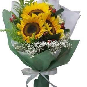 This bloom consists of sunflowers, hypericums, golden phoenix and white baby's breaths.