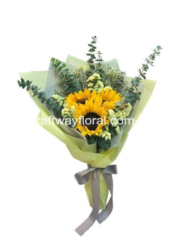 This bouquet consists sunflowers, yellow caspias,yellow statices and eucalyptus.