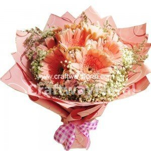 This bouquet consists of pink gerberas, white baby's breaths as well as purple caspias.