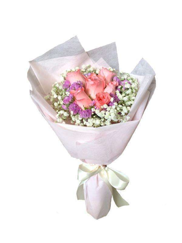 Give her this dreamy,bubblegum-like rose bouquet that will make her rosy cheeks blushes with the color.This bouquet consists of pink roses, white baby's breaths as well as light purple statices.