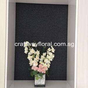 Arrangement consists of white vanda orchids with pink flowers.