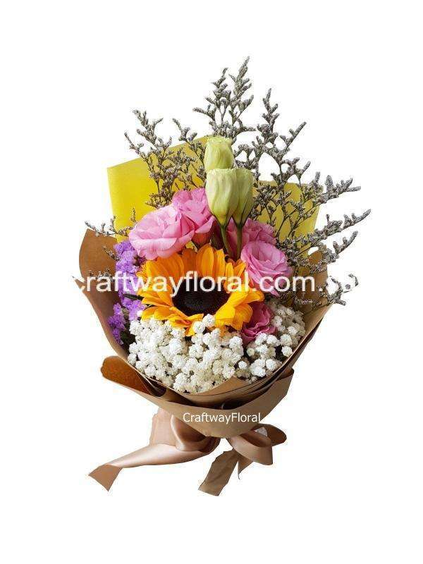 Image consist of single sunflower with fillers wrapped professionally in a bouquet.