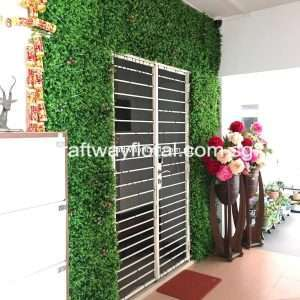 Artificial Green Wall Installation surrounding door.