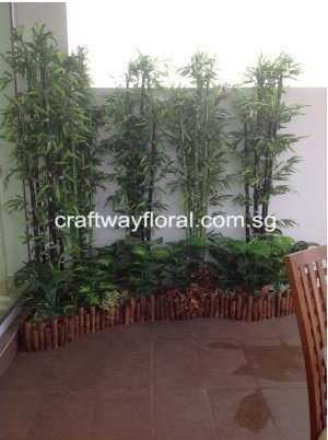 Artificial Bamboo Plants decorated together with other varieties of smaller plants.
