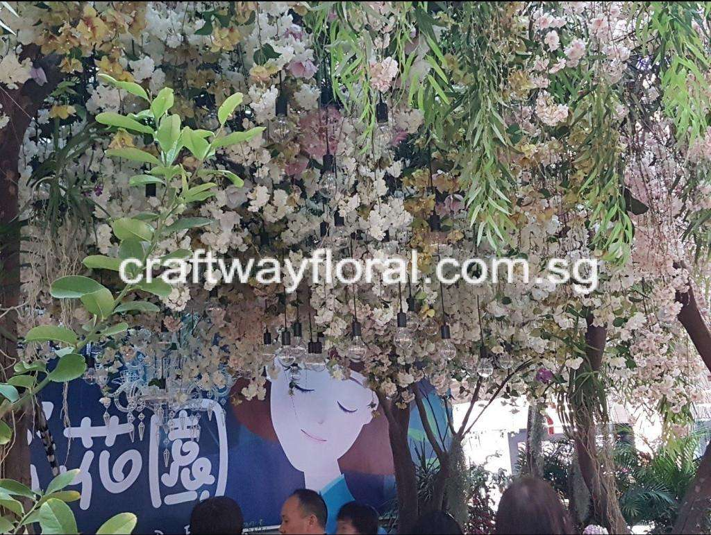 Atrium Flower Decor decorated with dropping artificial flowers and foilages.