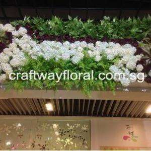 Green Wall Decor with artificial white flowers