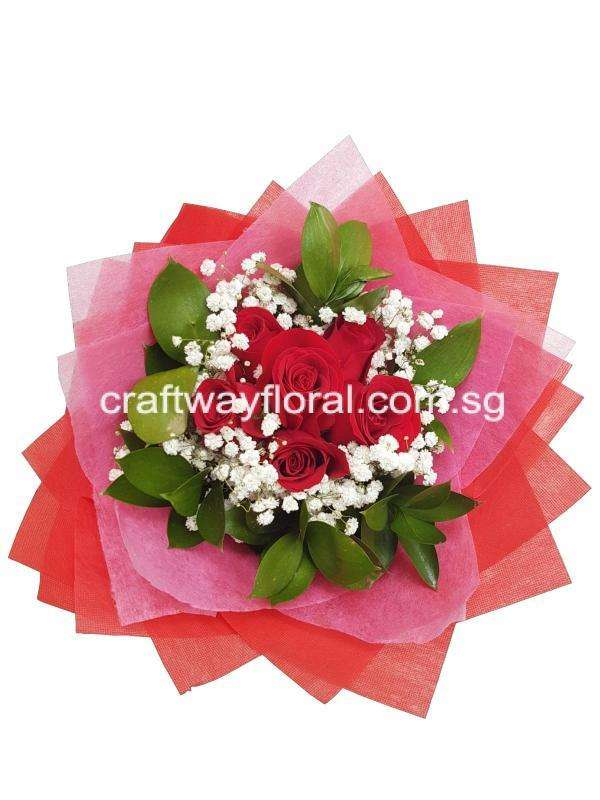 Red Roses coupled with white baby's breaths and foilages in pink and red wrapping.