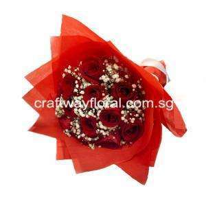 Blooms consist of Red roses and White Baby's Breaths wrapped in bright red wrapping.