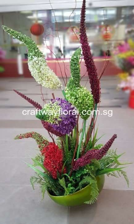 The artful elegance of buzz lavender flowers and fern styles in a galvanized metal vase.
