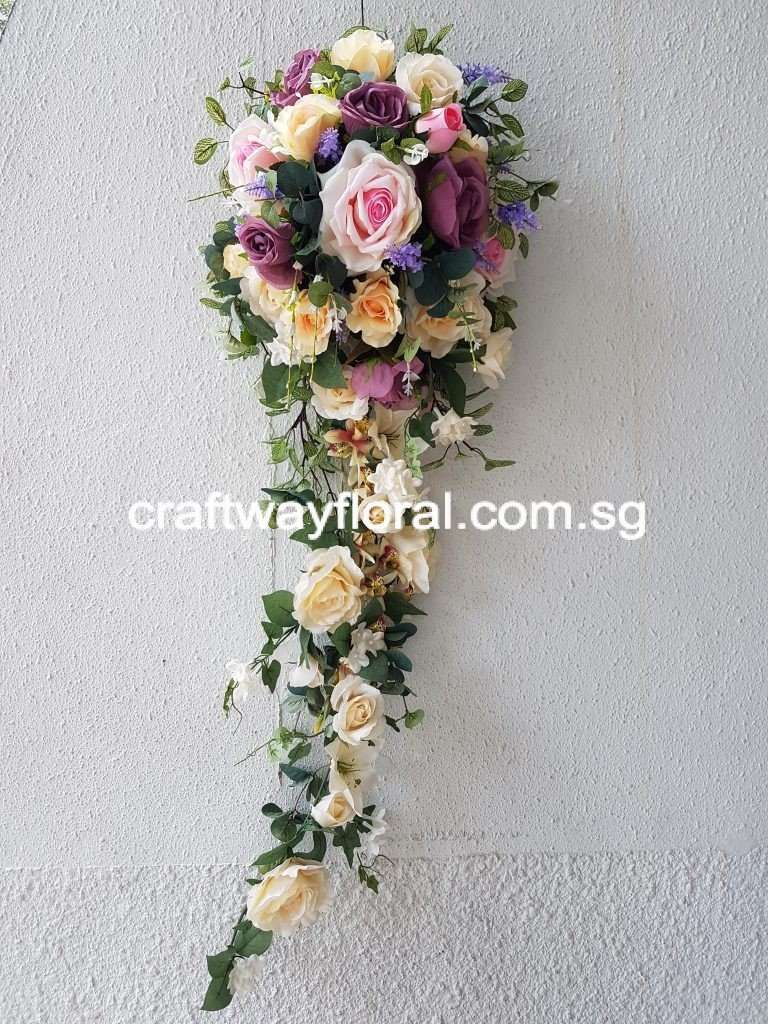 Mixtures of pastel artificial flowers in cascading form.