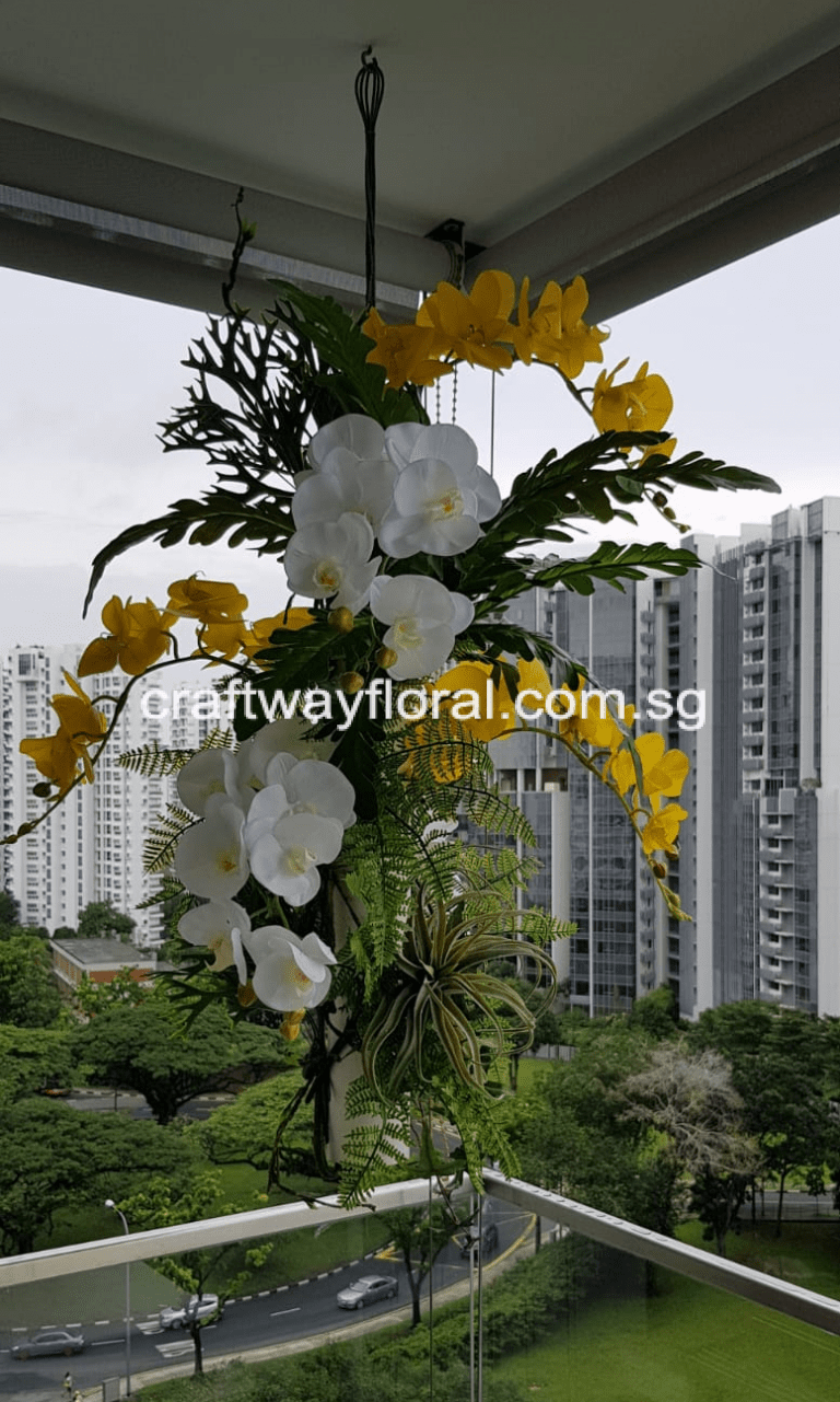 Artificial High-grade realistic orchids arranged together with other foilages as a hanging arrangement. Bringing colors and live to an empty balcony space.