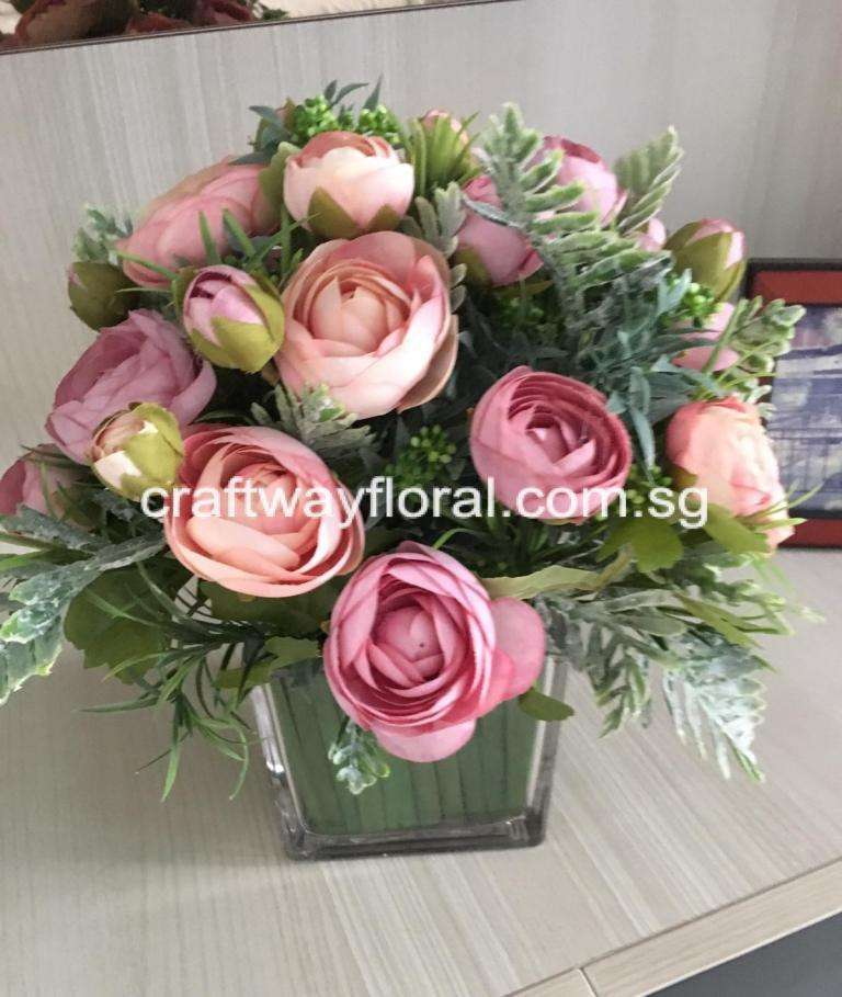 Pastel ranunculus arrangement suitable as coffee-table centrepiece, bringing soft, soothing, milky colors to the living space.