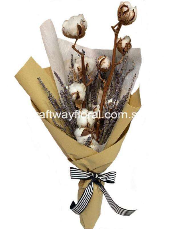 Dried Cotton Bulb Flowers teemed together with dried lavender flower stalks wrapped in kraft paper to give a rustic feel.