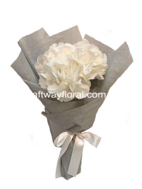 White hydrangea bouquet wrapped nicely.