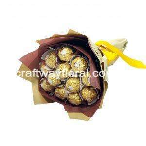 Edible Rocher wrapped in brown and kraft wrapping.