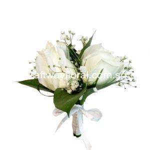 This grand corsage / boutonniere is made with fresh white roses and wrapped by ivory satin ribbon and a bow.
