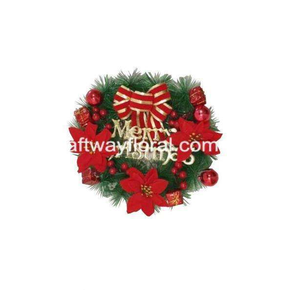 Christmas wreaths are a classic yet easy way to lit up the Christmas mood. This Christmas wreath is decorated with faux poinsettias, ribbons and ornaments.