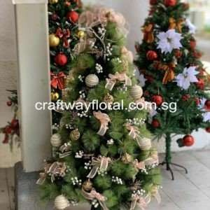 Blush pink, champagne, and gold ornaments and ribbons Christmas TreeDecoration Details.