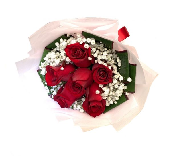 This bouquet consists red roses, white baby's breaths & cordyline leaves.
