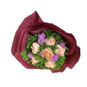 Blooms contain Champagne Roses, Light Purple Statices, and Pin Pa Leaves.
