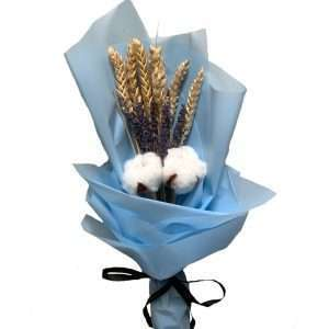 This bloom consists of cotton flowers, dried lavenders, dried wheats.