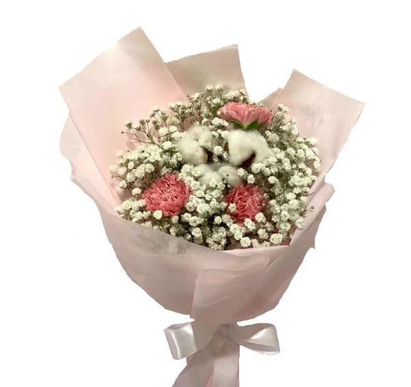 Pink Carnations with cotton flowers and white baby's breaths wrapped nicely with light pink wrapping.
